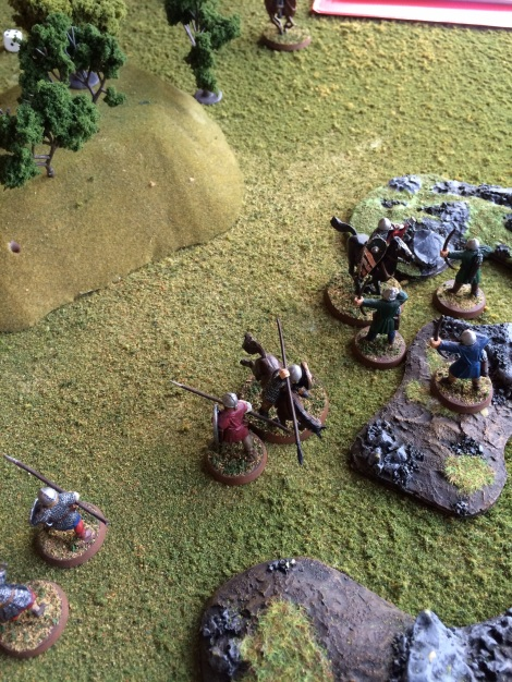Norman knights charge into Saxon archers.
