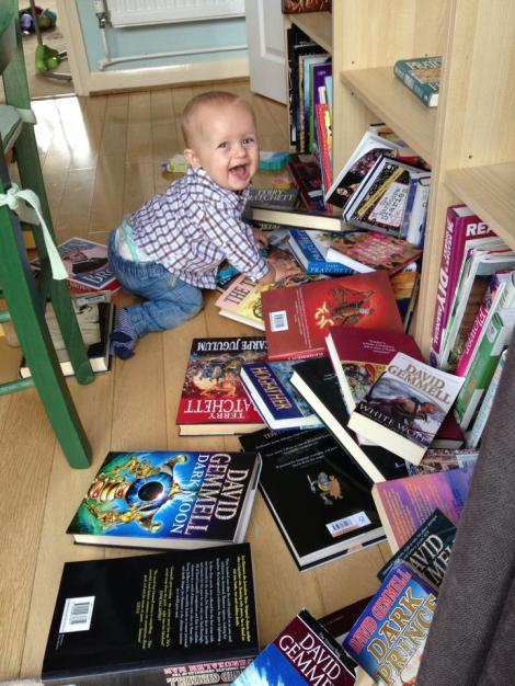Baby Sam playing with the books